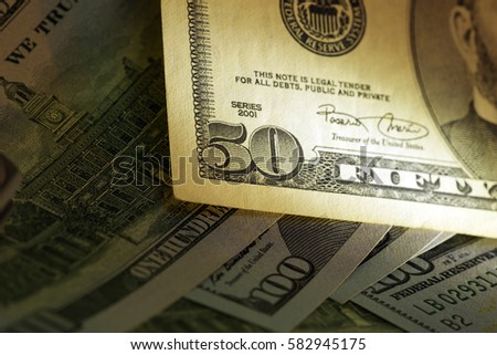 Part of fifty dollar bill. Art light shooting.