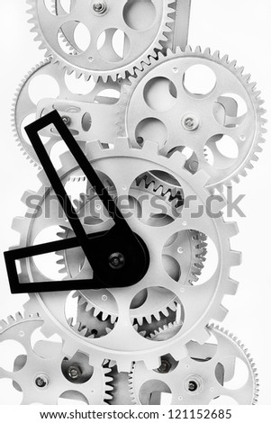 Part of gears in a mechanical clock on a light background - stock photo