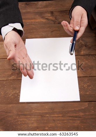 part of hands signing a contract - stock photo