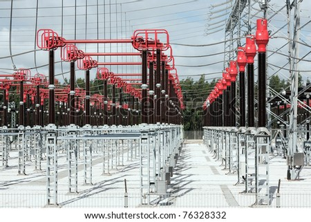 Part of High Voltage Station connectors against sky and woods - stock photo