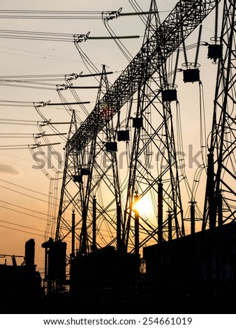 Part of high-voltage substation with switches and disconnectors with sunset - stock photo