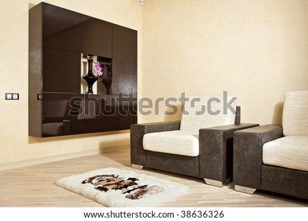 Part of interior with armchair, carpet and niche - stock photo