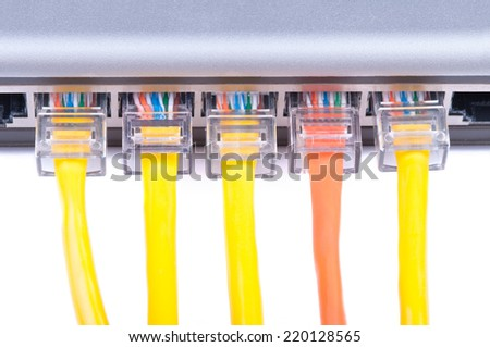 Part of lan ethernet switch with five network cables plugged in. Isolated on white background. - stock photo
