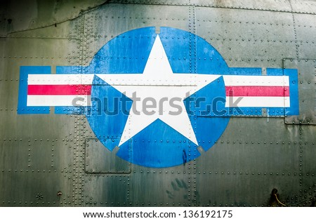 Part of military airplane with United States Air Force sign. Big white star in blue circle with stripes aside. War aircraft in metal plates. Military aviation. Retro style. Safety and protection. - stock photo
