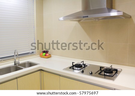 Part of modern apartment kitchen with metal appliances. - stock photo