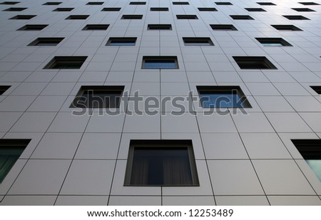 Part of modern business building with colorful windows - stock photo