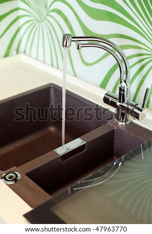 Part of modern Kitchen interior with Sink and falling water jet