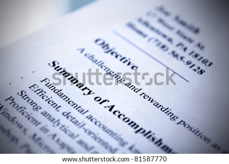Part of modern resume close-up. Blue tint with shallow DOF. Tilt view. - stock photo