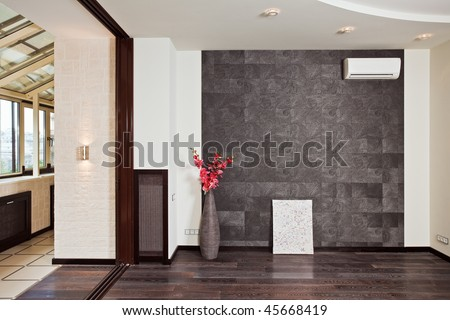 Part of modern studio (drawing room) interior with pink orchid in a vase - stock photo
