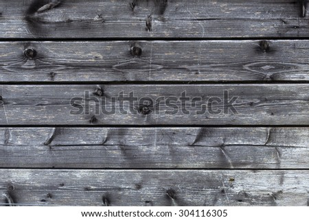 part of old black and grey wooden barn wall - stock photo