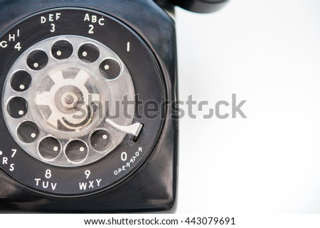 part of old black phone with dust and scratches on white background  - stock photo