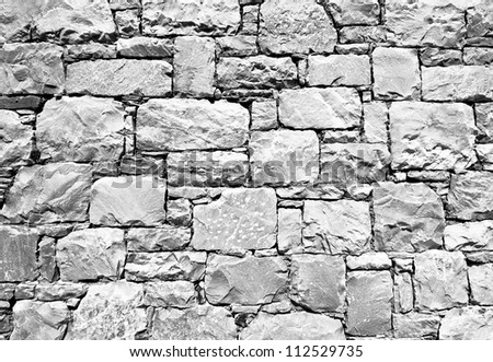 Part of old brick and stone wall / black and white monochrome - stock photo