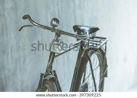 Part of old vintage bike used as illustrations for text and  background.