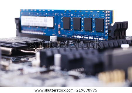 Part of PC main board with memory module. Closeup with shallow DOF. Isolated on white background. - stock photo