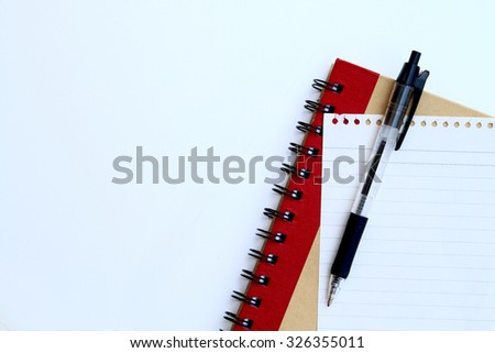 part of pen on paper and notebook on white background - stock photo