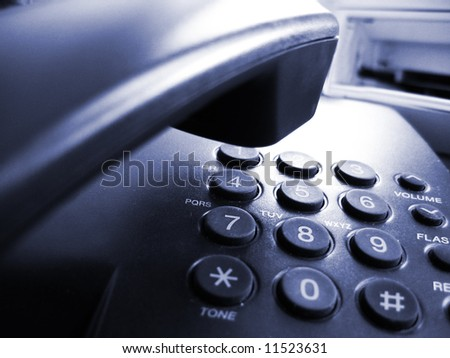 part of phone with receiver and buttons, blue toned - stock photo