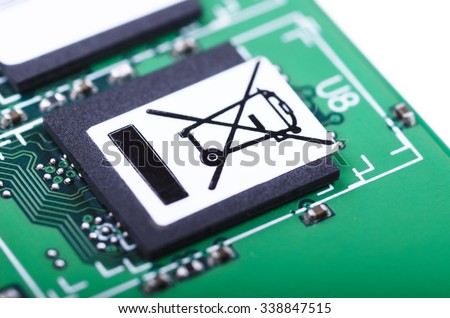 "Part of printed circuit board with ""do not trash"" symbol. Closeup with shallow DOF. - stock photo"