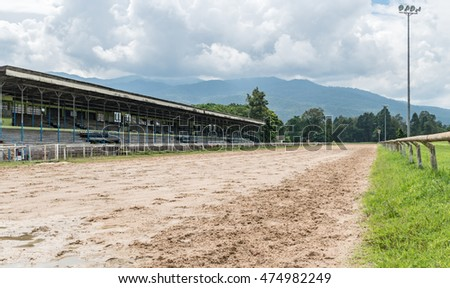 Part of racecourse with old grandstand and view of mountain