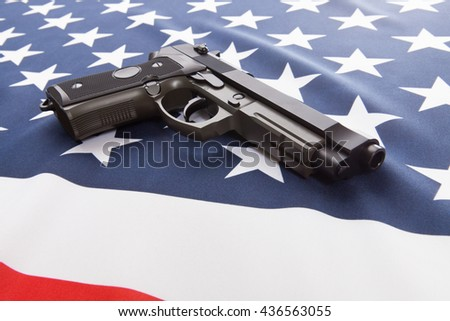 Part of ruffled national flags with hand gun over it series - USA - stock photo