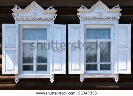 Part of rural house. Two windows. - stock photo