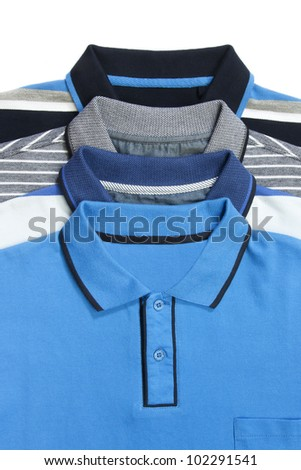 Part of some man polo shirts on white - stock photo