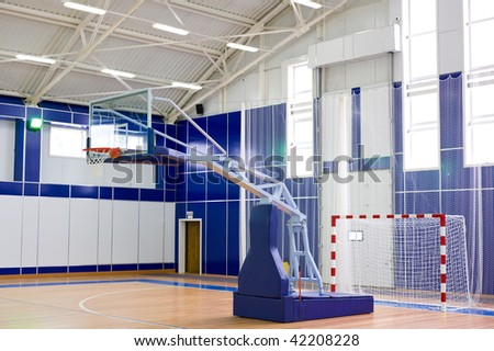 part of sports gym with modern basketball upright and soccer goal - stock photo