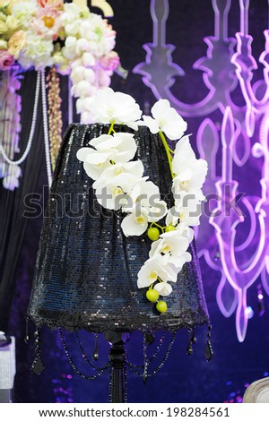 Part of stylish indoor interior with flowers - stock photo