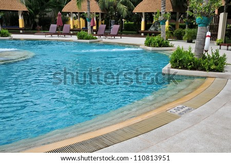 part of swimming pool with blue water - stock photo