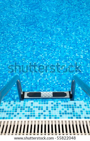 Part of swimming pool with metal ladder - stock photo