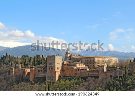 Part of the Alhambra palaces and fortifications against the mountains of Granada, Spain