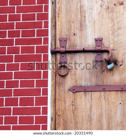 Part  of  the  antique  door  with the iron lock. - stock photo