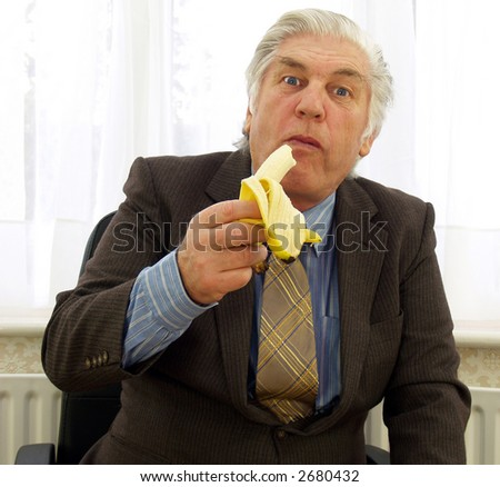 Part of the ape family a businessman - stock photo