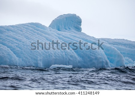 Part of the big beautiful larger iceberg in ocean, Antarctica  - stock photo