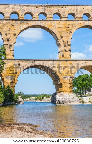 Part of the bridge. Three-tiered aqueduct Pont du Gard - the highest in Europe. Provence, spring sunny day - stock photo