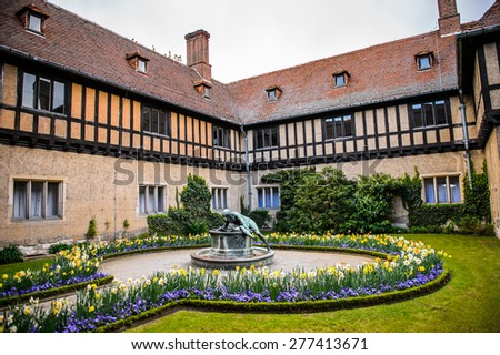 Part of the Cecilienhof Palace, a palace in Potsdam, Brandenburg, Germany. - stock photo