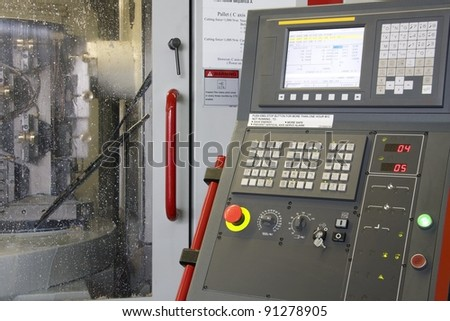 part of the cnc milling machine with control panel - stock photo