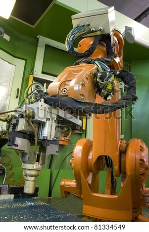part of the cnc milling machine with robot - stock photo