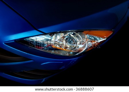 Part of the dark blue car on a black background - stock photo