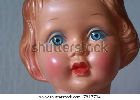 Part of the face of an old doll. - stock photo