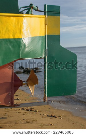 part of the fishing boat, propeller and rudder - stock photo