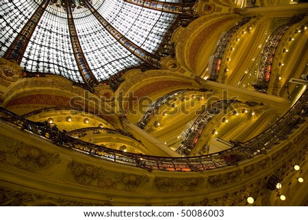 Part of the floors and of the beautiful arch in the famous shopping center Galeries Lafeyette in Paris, capital of France, Europe - stock photo