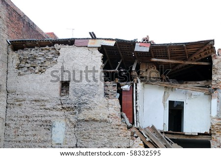 Part of the house destroyed during earthquake - stock photo