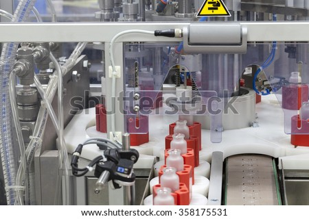 part of the machine for the automatic filling of perfume - stock photo