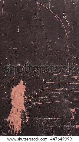 part of the metal scratched and rusting black gate with pink chaotic spots of a beautiful look,