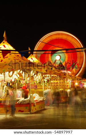 part of the midway at the 2009 Douglas County Fair in Roseburg Oregon at night. - stock photo