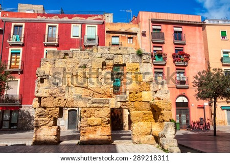 Part of the old medieval wall in the city center of Tarragona, Spain - stock photo