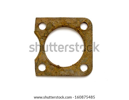 Part of the old rusty cylinder head gasket isolated on white background - stock photo
