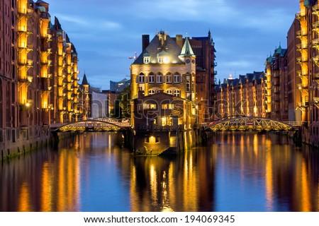 Part of the old Speicherstadt in Hamburg illuminated at night - stock photo
