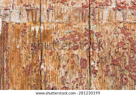 Part of the old wooden door with paint crumbles on it. textural composition - stock photo