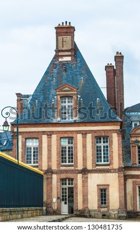 Part of the Palace of Fontainebleau, one of the largest French royal castles - stock photo